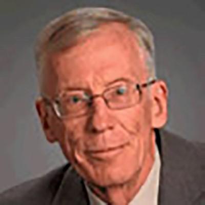 JOHN A. BUZACOTT